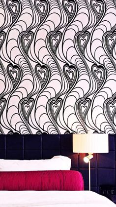 We love the stylized, graphic wallpaper and chic quilted leather headboards. #Ireland