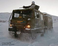 A Viking armoured personnel vehicle armed with a .50 cal machine gun, on patrol with Royal Marines of Whiskey Company, 45 Cdo in Norway, as part of their Winter Deployment.