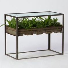 It's either really awful or really cool, can't decide which...Terrain Terrarium Side Table  #shopterrain