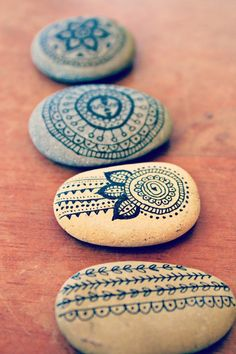 Painted stones, similar in idea to the antique crochet lace I drew onto matte painted ornaments in 2011.