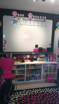 Homeschool Classroom-Homeschooling the new cool way! Under $100 lettering from Michaels, rack  containers from Ikea, white bookcases from Ikea.