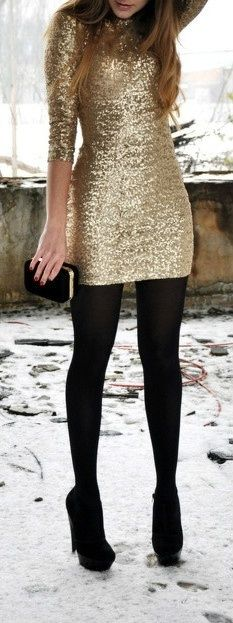 Gold glitter dress and opaque black tights.