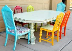 Love the bright colors around the basic table. Could happy up a white kitchen.... old furniture, kitchen tables, dining room tables, dining chairs, painted chairs, kitchen chairs, restore furniture, dining room chairs, bright colors