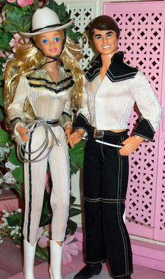 Western Barbie and Ken. My sister is almost a decade older than I am. You know I was playing with all of her old toys! There was a Western Skipper and I think several horses.  Oh, those were the simple days!