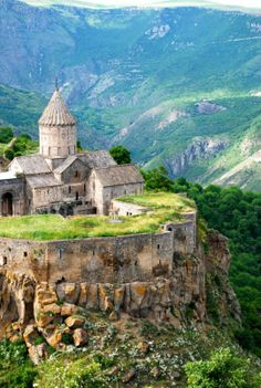 """The Tatev Monastery is a 9th-century monastery located on a large basalt plateau near the Tatev village in Syunik Province in southeastern Armenia. The term """"Tatev"""" usually refers to the monastery. The monastic ensemble stands on the edge of a deep gorge of the Vorotan River."""