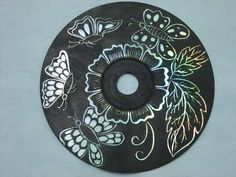 CD Scratch Board Art  Take any old CD and cover it with a dark colored acrylic paint; let dry, then sketch/scratch your design with something sharp; Coat w/ sealer.