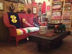 pillows covered in vintage blankets with vintage pennants stitched on them.  They're at a shop in Chicago called Brimfield.