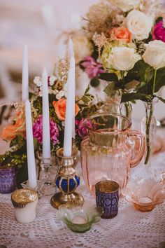 vintage glass and candle holders, photo by Forged in the North http://ruffledblog.com/handcrafted-finger-lakes-wedding #weddingideas #centerpieces