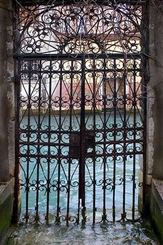 Venice -- I love the detailed scrolling of the gate in this photo.