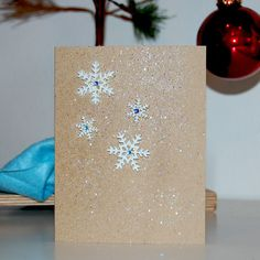 Snowflake Card w/ Glitter    Inside - blank    Please contact the seller with details of your order. We are always willing to customize.  Need more than one? Contact seller for a discount on larger quantities.    size 4.25X5.5  Comes with envelope. You can always request a color for the envelope, but we usually just choose what looks best from our inventory.