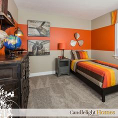 Candlelight Homes, Utah, Bedroom, Kids room, tan carpet, Orange bedroom, Boys room, Striped bedding, bedspread, Wall Art, Brown dresser, Orange lamp, Orange wall