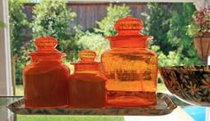 Orange Glass Canisters!  http://orangekitchendecor.siterubix.com/ Retro Art Glass: Vintage Retro Orange Glass Kitchen or Bar Canister Set #ppgorange
