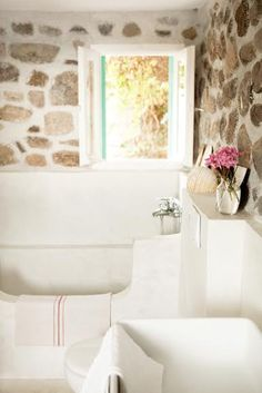 Stone walls give a nice cottage like feel to any home.