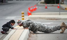 May 8_A child looks at the chief sergeant Jose Padilla doing push-ups during the Veteran's Day parade in Fresno | California