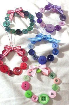 Button Wreaths, nice inspiration. could also put these on a christmas card to then be used as a decoration. by Peacewytch, via Flickr