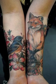 Red fox and little bird tattoo on arms