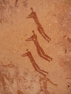 "Three Swimmers from the Foggini-Mestakawi Rock Art Site. ""These have been famously called 'The Swimmers,' heralding a time when lakes scattered the landscape that is now the Saharan desert."""