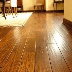 Bob's Tip of the Day: Hardwood floors are often a home's most inviting feature. You can keep them that way with proper care. Use cleaning products designed for hardwood—other cleansers can cause damage. A little water on a cloth works wonders on spills, but too much water will damage the wood. For fabulous floors, vacuum frequently using a hardwood floor attachment to grab dust from between boards without scratching.