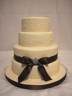 elegant&simple...love it!! I would do a purple bow instead if it was my wedding cake!!