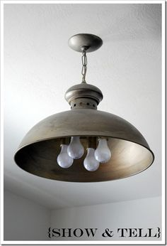 this was an ugly brass light fixture before she painted it and made it awesome