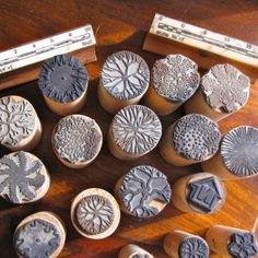 """A very cool set of 40 vintage rubber stamps, meant to allow a person to create a landscape or garden design.   The stamps are affixed to round wooden dowels that range in diameter from about 3/8"""" to about 1 1/4"""". There are three rectangular stamps--one that represents a ground cover and two that show scale (1/8"""" = 1 foot and 1/4"""" = 1 foot). The round stamps represent a variety of trees, shrubs, and plants."""
