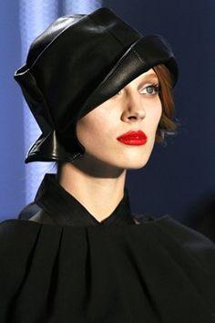 Short hair, black leather hat. Modern day Daisy Buchanan