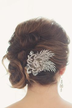 crystal hair pin, photo by Maria Mack Photography http://ruffledblog.com/pennsylvania-circus-inspired-wedding #weddinghair #bridal