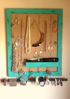 DIY Jewelry holder made with a picture frame and burlap.