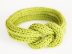 Hand made knitted green bracelet, two cord loops with nautical chineese knot. $19.00, via Etsy.