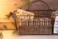 "Rustic Wire Basket...with old cheese box, old wooden clothespins & ""Joy"" tags."