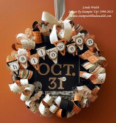 This is a Halloween wreath I created for my Halloween challenge here http://www.stampwithlindawalsh.com/15/post/2013/09/october-2013-challenges.html  Hope you'll join in on the challenge to win $10 of Stampin' Up! products.  You can also go here for more information on this project http://www.stampwithlindawalsh.com/9/post/2013/10/halloween-wreath-witches-brew-dsp.html