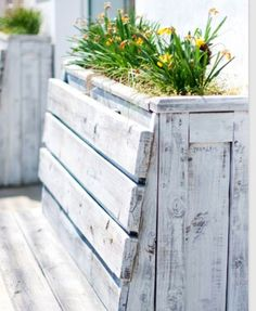 Deck bench with built in planter behind seat back