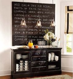 Paint canvases with chalkboard paint