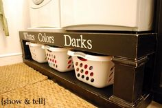 love this- a shelf under the washer and dryer to store laundry baskets, and it raises the machines so you don't have to bend!