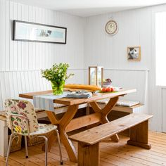 A picnic table-inspired dining alcove and floor-to-ceiling beadboard give this cozy nook a casual, homey appeal. | Photo: Douglas Gibb/GAP Interiors