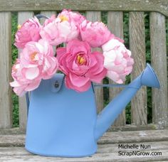Michelle Nun's Peonies 'Paperie' -- she uses the Cricut Giant Flowers cart but tweaks it to make her peonies life-life and gives all the details to follow her lead!!    I have a friend that could make us some for the shower!