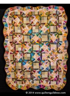 """From The Stash"" by Maureen Martin.  Dresden fan variation. 2014 Sydney quilt show, Judge's Commendation award"
