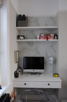 Maximized corner nook workspace with built in desk. Nice use of limited space.