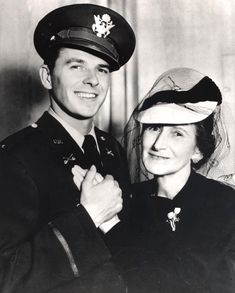 Lieutenant Ronald Reagan posing with his mother, Nelle 1940s