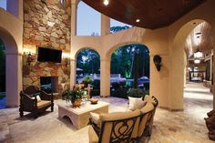 An outdoor room becomes the prime gathering spot for socializing with family and friends after a day in the pool. http://www.luxurypools.com/builders-designers/marquise-pools-llc.aspx Marquis Pools, LLC; Home project building designer: Patrick Berrios; Landscape architect: Chris D. Smith; Photography by Paul Ladd, www.laddphotography.com