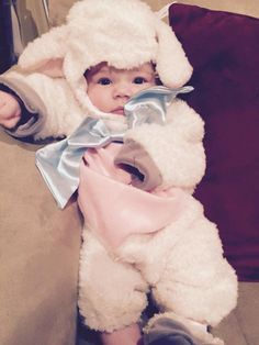 """Your little lamb will look so precious (and stay so cozy!) in this storybook-perfect baby sheep costume. Wonderful quality: plushy on the outside, silky on the inside. Baby lamb jumpsuit is fleecy and soft, with a satiny tummy, jaunty bow, and stuffed tail, plus snap legs for easy diaper changes..."""