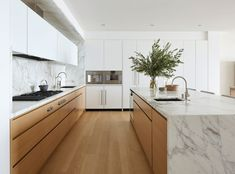 Few things are as luxurious as a marble kitchen. Check out these 9 kitchens that feature the glam material.