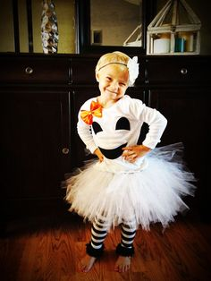 Little girl/baby girl Halloween ghost costume including leg warmers and cluster ghost headband.. $58.00, via Etsy.