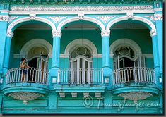 An arched balcony overlooking the Prado (Paseo de Marti) La Habana, Cuba     Keywords: Stock Photo Picture Latin America Caribbean Habana Havana La Habana Cuba Habana Vieja Old Havana Ciudad de la Habana Cuban Balcony Turquoise Watching Killing Time Facade Prado Paseo de Marti Colonial Architecture Horizontal Architecture