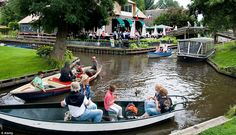 Giethoorn, Netherlands - no roads in this town. Travel by water or foot.  <3