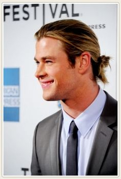 Hemsworth with a mini ponytail and loose strands. #chrishemsworth #hair #thor