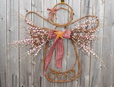Grapevine Angel. I made this years ago and use it as my tree topper.... I eliminated the 'hearts' on the bottom and it was so easy to make.