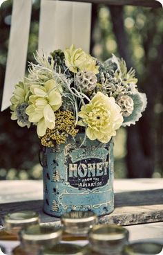 vintage tin cans add a sense of sentimentality to any floral arrangement