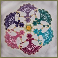 This pattern will be free for one week only!   Expires Tuesday, June 10th, 2014 Crochet Memories Blog: Friendship Garden Crinoline Circle Doily Work up a beautiful crinoline circle doily boasting six girls joined hand in hand with baskets of flowers.  The girls encircle a flower center that's sure to please everyone!
