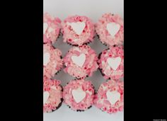 Mini cupcakes with pink chocolate curls and a white fondant heart